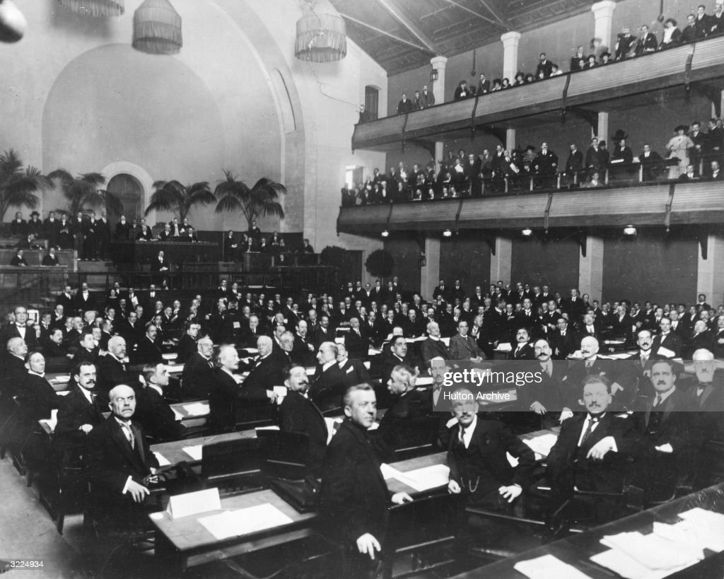 Members of the League of Nations looking over their shoulders during an assembly in Geneva, Switzerland.