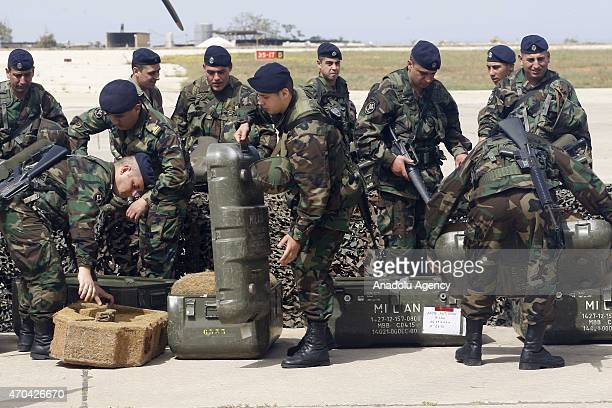 Members of the Lebanese Army receive arms at a ceremony as the Lebanese army receive the first shipment of French arms within the context of a...