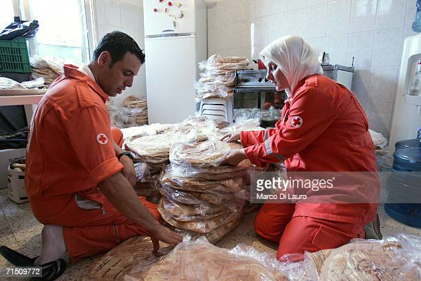 Members of the Lebanese Red Cross store bread to distribute to the civilian population July 24 2006 in Tyre Southern Lebanon According to reports on...