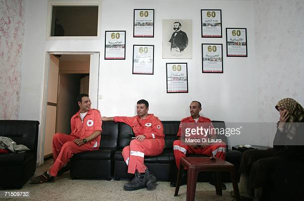 Members of the Lebanese Red Cross wait at their headquarters for a call to pick up injured victims of the Israeli bombing campaign July 24 2006 in...