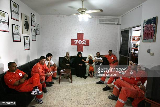 Members of the Lebanese Red Cross wait at their headquarters to for a call to pick up injured victims of the Israeli bombing campaign July 24 2006 in...