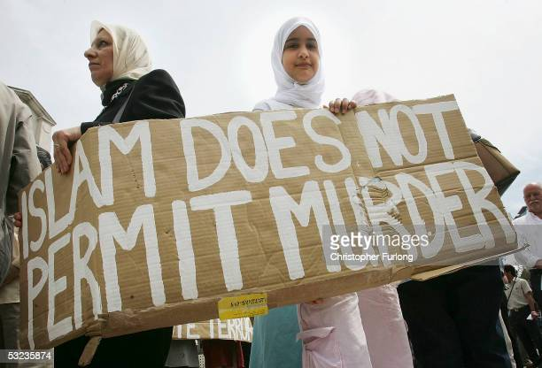 Members of the Leeds Muslim Community stand in Millennium Square to mark the two minute tribute to the victims of the London bombings on July 14 2005...