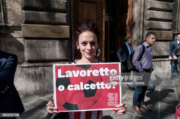 Members of the Left Italian party protest in front the Ministry of Labour against the Minister Giuliano Poletti on March 29, 2017 in Rome, Italy....