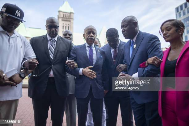 Members of the legal team in the prosecution of former officer Derek Chauvin, family of George Floyd, and members of the National Action Network pray...