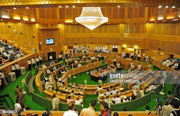 Members of the legislative assembly gather in Jammu and Kashmir's state assembly prior to the start of a session in Srinagar on July 29 2009 The main...