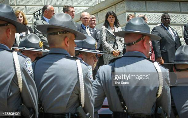 Members of the legislature and Gov Nikki Haley watch as the South Carolina Highway Patrol Honor Guard carries the casket of the Sen Clementa Pinckney...