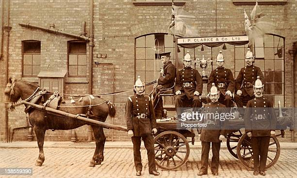 Members of the Leicester Fire Brigade pose with a trophy circa 1910