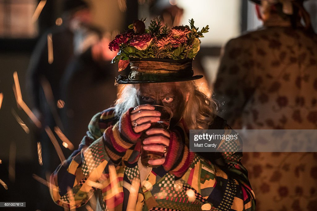 Members of the Leominster Morris gather for a drink before they lead the crowd from the Hobson Brewery in Frith Common to the nearby apple orchard to take part in Oldfields Orchard Cider wassailing ceremony ahead of today's Twelfth Night on January 4, 2017 near Tenbury Wells in Worcestershire, England. The annual tradition sees morris dancers and mummers gather before a procession to a local orchard to perform a ceremony that involves placing a cider-soaked piece of Christmas cake on the branches of an apple tree and sprinkling cider around its roots, before lighting torches, dancing and singing the Wassail Song as to ensure a good crop of cider apples for the year ahead. The tradition of wassailing, which differs from place to place in cider producing counties, has its roots in ancient pagan traditions and is held on various dates after Christmas as a plea to the spirits of the orchard to provide a good crop, is seeing something of a modern revival as cider makers across the West Country reintroduce the ritual of toasting their apple trees for good luck. In the UK, January 5th is generally observed as the last day of Christmas festivities as it is the eve of the Epiphany.