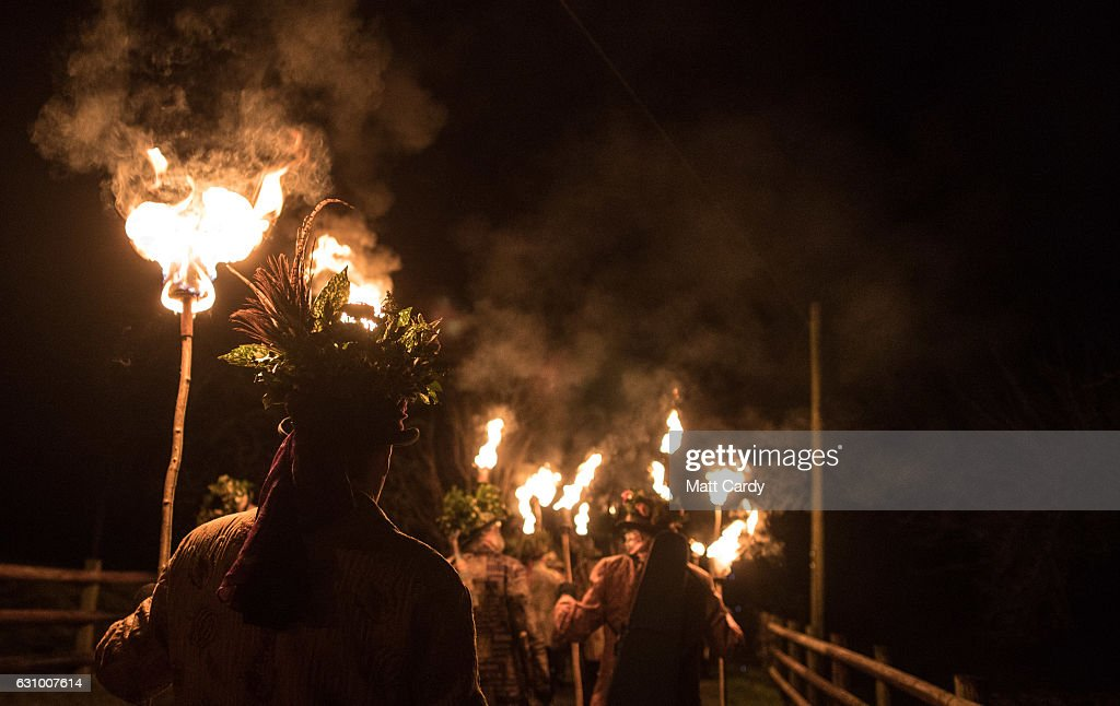 Members of the Leominster Morris lead the crowd from the Hobson Brewery in Frith Common to the nearby apple orchard to take part in a torchlit Oldfields Orchard Cider wassailing ceremony ahead of today's Twelfth Night on January 4, 2017 near Tenbury Wells in Worcestershire, England. The annual tradition sees morris dancers and mummers gather before a procession to a local orchard to perform a ceremony that involves placing a cider-soaked piece of Christmas cake on the branches of an apple tree and sprinkling cider around its roots, before lighting torches, dancing and singing the Wassail Song as to ensure a good crop of cider apples for the year ahead. The tradition of wassailing, which differs from place to place in cider producing counties, has its roots in ancient pagan traditions and is held on various dates after Christmas as a plea to the spirits of the orchard to provide a good crop, is seeing something of a modern revival as cider makers across the West Country reintroduce the ritual of toasting their apple trees for good luck. In the UK, January 5th is generally observed as the last day of Christmas festivities as it is the eve of the Epiphany.