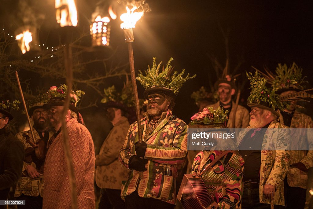 Members of the Leominster Morris perform in the Oldfields Orchard Cider wassailing ceremony ahead of today's Twelfth Night at Hobson Brewery in Frith Common on January 4, 2017 near Tenbury Wells in Worcestershire, England. The annual tradition sees morris dancers and mummers gather before a procession to a local orchard to perform a ceremony that involves placing a cider-soaked piece of Christmas cake on the branches of an apple tree and sprinkling cider around its roots, before lighting torches, dancing and singing the Wassail Song as to ensure a good crop of cider apples for the year ahead. The tradition of wassailing, which differs from place to place in cider producing counties, has its roots in ancient pagan traditions and is held on various dates after Christmas as a plea to the spirits of the orchard to provide a good crop, is seeing something of a modern revival as cider makers across the West Country reintroduce the ritual of toasting their apple trees for good luck. In the UK, January 5th is generally observed as the last day of Christmas festivities as it is the eve of the Epiphany.