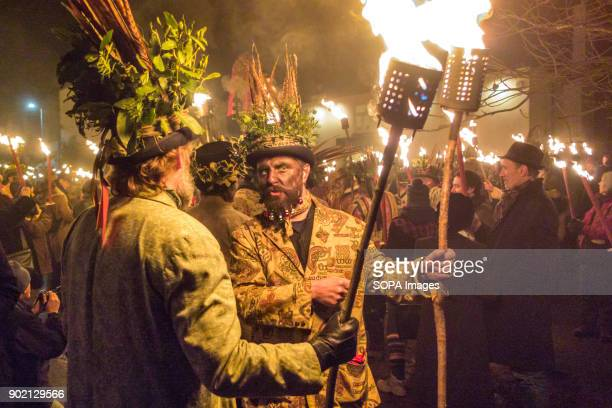 Members of the Leominster Morris seen gathering with crowds while exchanging a chat at the Crown Inn before heading to the apple orchard of Mr...
