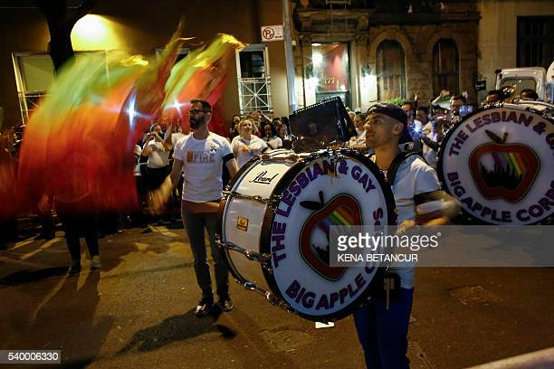 Members of the lesbian and Guy big apple corps marching band play during a vigil in solidarity for the victims killed at Pulse nightclub in Orlando...