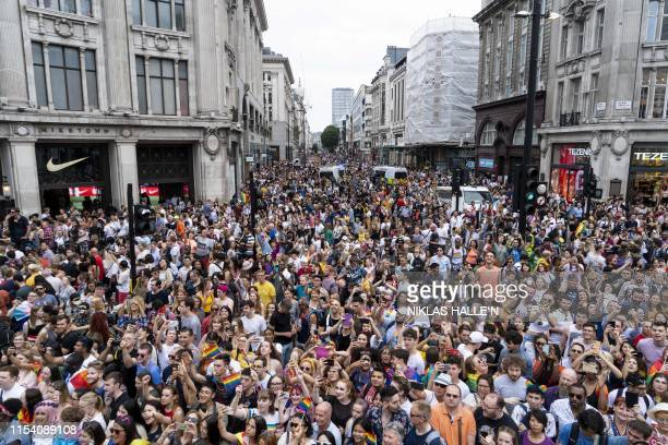 Members of the Lesbian Gay Bisexual and Transgender community take part in the annual Pride Parade in London on July 6 2019