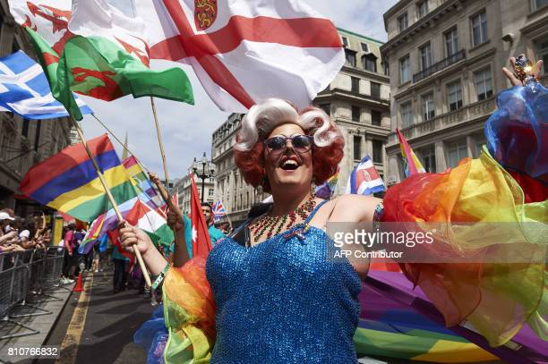 Members of the Lesbian Gay Bisexual and Transgender community take part in the annual Pride Parade in London on July 8 2017 / AFP PHOTO / NIKLAS...