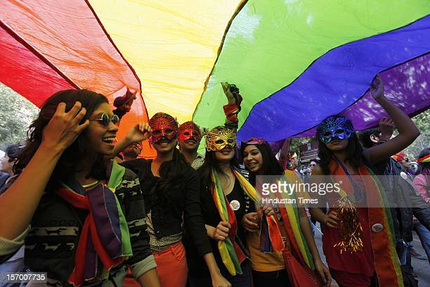 Members of the lesbian gay bisexual transgender community and supporters attend the 5th Delhi Queer Pride parade on November 25 2012 in New Delhi...