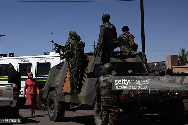 Members of the Lesotho national army are seen next to a South African Police armoured vehicle outside Maseru on October 1, 2014. Lesotho Mounted...