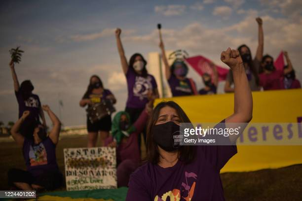 Members of the 'Levante de Mulheres' raise their fists during a rally against President Jair Bolsonaro in front of the National Congress on July 2,...