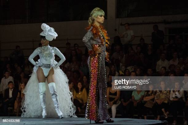 Members of the LGBTI community model a creation by Colombian designer Diego Morales during the Walkway Inclusion fashion show in Cali Colombia on...
