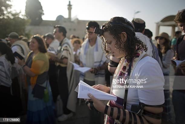Members of the liberal Jewish religious group Women of the Wall wearing phylacteries and the 'Tallit' shawl traditional Jewish prayer apparel for men...
