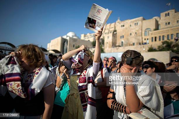 Members of the liberal Jewish religious group Women of the Wall wearing phylacteries and the Tallit shawl traditional Jewish prayer apparel for men...
