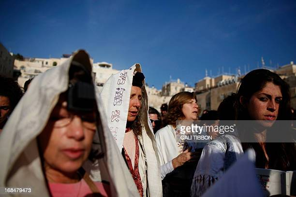 Members of the liberal Jewish religious group Women of the Wall wear phylacteries and the Tallit shawl traditional Jewish prayer apparels for men as...