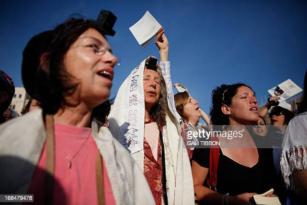 Members of the liberal Jewish religious group Women of the Wall wear phylacteries and the Tallit shawl traditional Jewish prayer apparel for men as...