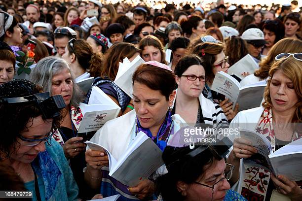 Members of the liberal Jewish religious group Women of the Wall wear phylacteries the Tallit shawl and kippah traditional Jewish prayer apparel for...