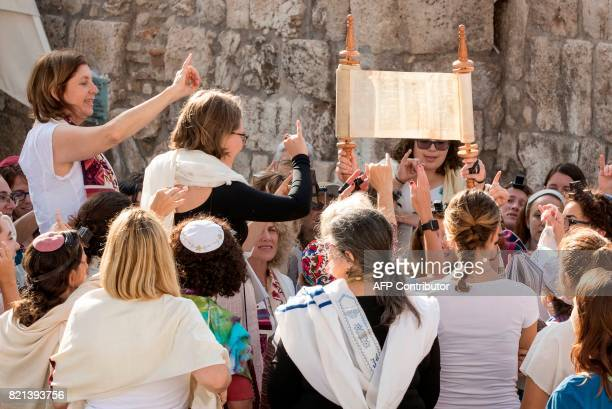 Members of the liberal Jewish religious group Women of the Wall wear phylacteries and the Tallit traditional Jewish prayer shawls for men as they...