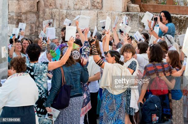 Members of the liberal Jewish religious group Women of the Wall wear phylacteries and traditional Jewish prayer shawls for men known as Tallit as...