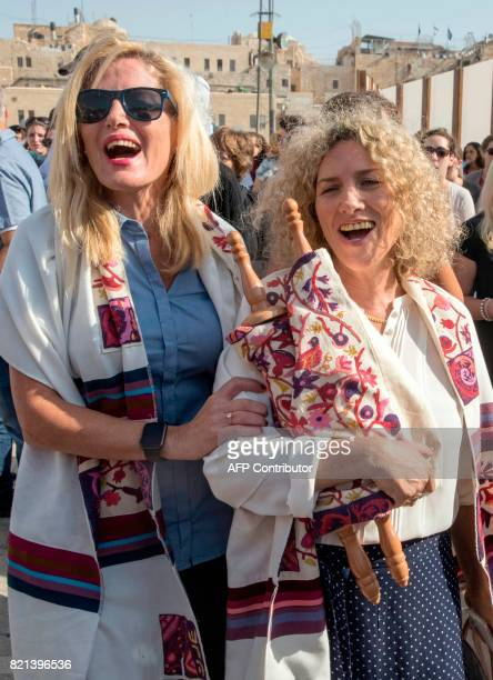 Members of the liberal Jewish religious group Women of the Wall wear traditional Jewish prayer shawls for men known as Tallit as they pray at the...