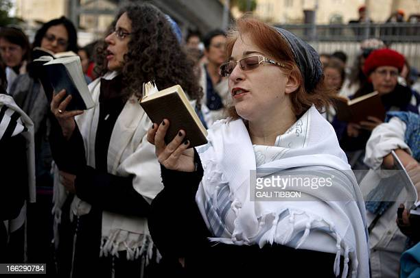 Members of the liberal religious group Women of the Wall wearing Tallit traditional Jewish prayer shawls for men pray at the Western Wall in...