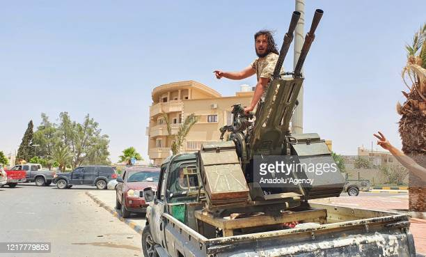Members of The Libyan Army celebrate after they liberated the strategic Tarhunah city, the last stronghold of warlord Khalifa Haftar in western Libya...
