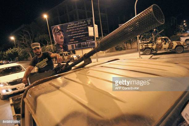 Members of the Libyan Special Forces loyal to the country's east strongman Khalifa Haftar patrol the streets in the eastern city of Benghazi on...