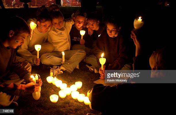 Members of the Littleton Colorado community gather for a candlelight vigil April 20 2000 in Robert F Clement Park near Columbine High School to...