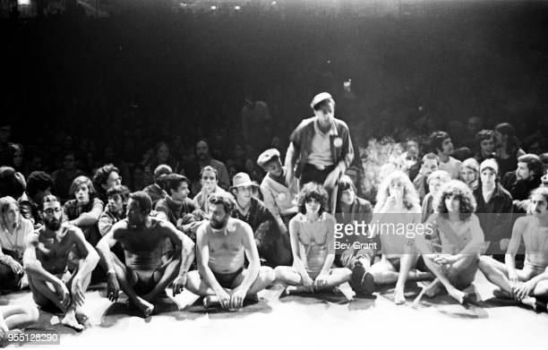 Members of the Living Theatre company along with audience participants perform 'Paradise Now' on stage at the Filmore East New York New York October...