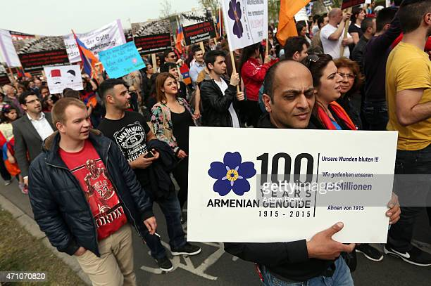 Members of the local Armenian community demonstrate for Turkey's recognition of the Armenian Genocide on its 100th anniversary on April 25 2015 in...