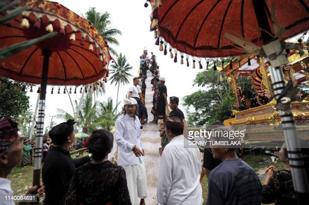 Members of the local community prepare a bade or cremation tower for the cremation of two late family members of Indonesian national hero I Gusti...