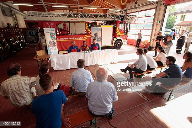 Members of the local fire brigade and rescue team speak with the media at their coordinating center near an underground cave where an explorer is...