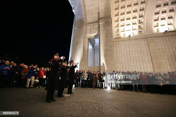 Members of the local fire brigade sound the Last Post at the Menin Gate Memorial to the Missing on March 26 2014 in Ypres Belgium This ceremony...