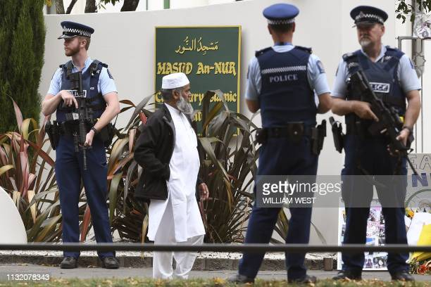 Members of the local Muslim community wait to enter the Al Noor mosque as it is reopened in Christchurch on March 23 2019 Muslims returned on March...