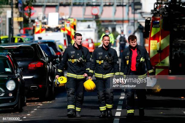 Members of the London Fire Brigade emergency service work near Parsons Green underground tube station in west London on September 15 following an...