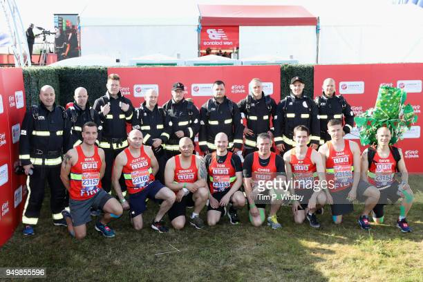 Members of the London Fire Brigade pose for a photo ahead of participating in The Virgin London Marathon on April 22 2018 in London England