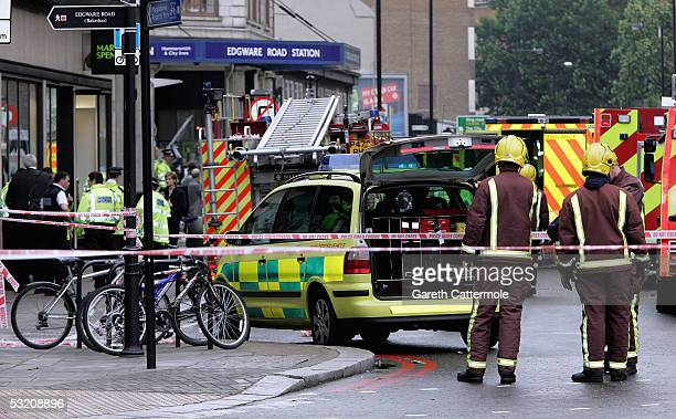 Members of the London fire service secure the area around Edgware Road underground station after several bomb blasts ripped across London's...