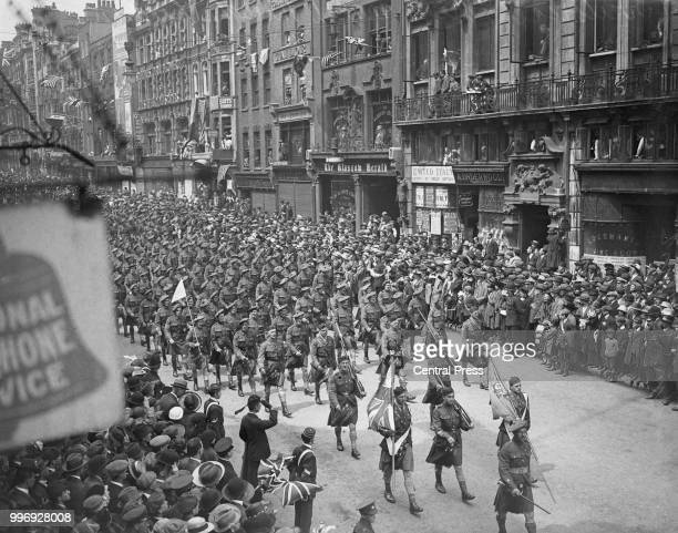 Members of the London Scottish regiment of the British Army march down Fleet Street towards Ludgate Circus during the London Victory Parade 19th July...