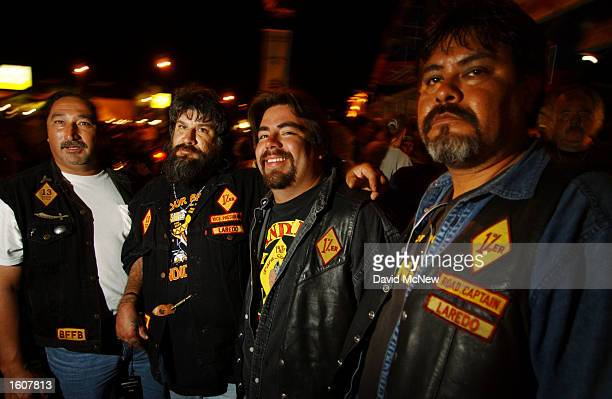 Members of the Loredo TX chapter of the Bandidos motorcycle club watch the scene on Main Street during the 61st annual Sturgis Motorcycle Rally...