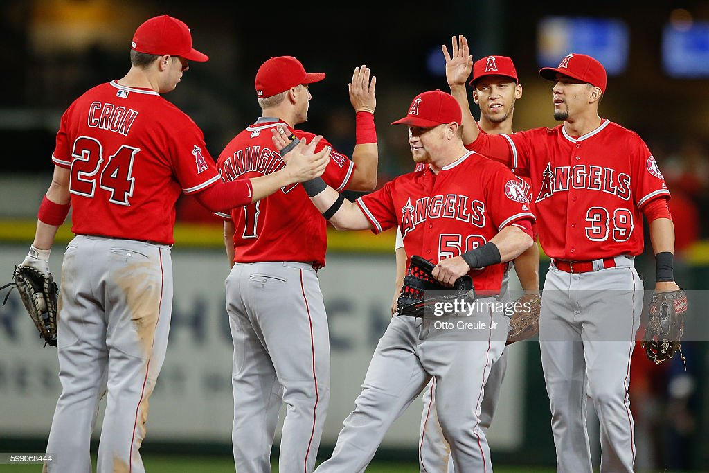 Members of the Los Angeles Angels of Anaheim celebrate after defeating the Seattle Mariners 10-3 at Safeco Field on September 3, 2016 in Seattle, Washington.