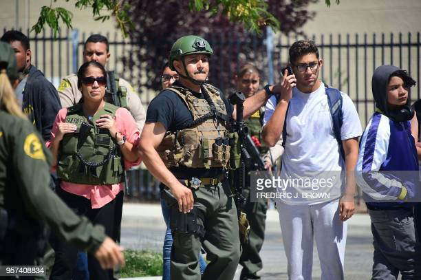 TOPSHOT Members of the Los Angeles county sheriff and others gather outside the school on May 11 2018 following reports of shooting at Highland High...