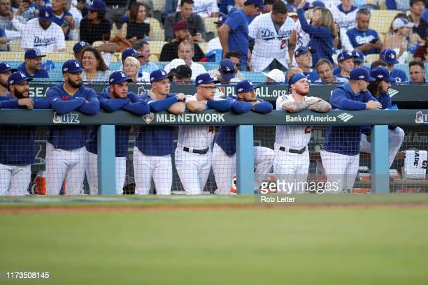Members of the Los Angeles Dodgers look on from the dugout during Game 1 of the NLDS against the Washington Nationals at Dodger Stadium on Thursday...