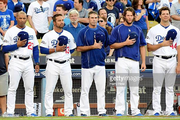Members of the Los Angeles Dodgers stand during the national anthem before game four of the National League Championship Series against the Chicago...