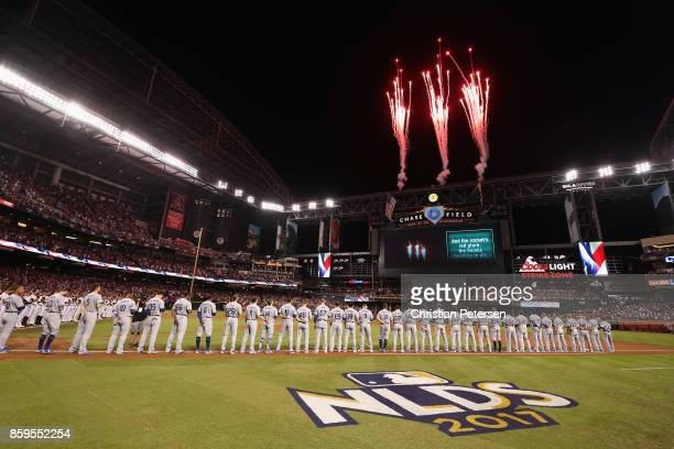 Members of the Los Angeles Dodgers stand for the National Anthem before the National League Divisional Series game three against the Arizona...